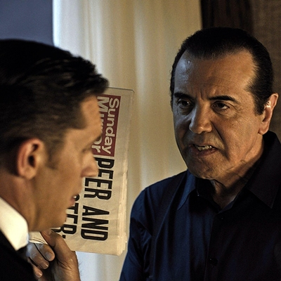 (L to R) Reggie Kray (TOM HARDY) doesn't see eye to eye with American businessman Angelo Bruno (CHAZZ PALMINTERI) in Legend.