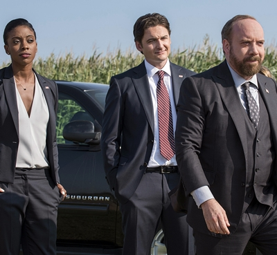"Condola Rashad, from left, as Kate Sacker, Toby Leonard Moore as Bryan Connerty and Paul Giamatti as Chuck Rhoades in season one of the TV series, ""Billions."""